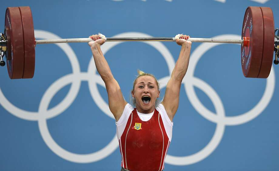 Ukraine's Yuliya Kalina competes during the women's weightlifting 58kg group A event at The Excel Centre in London on July 30, 2012, during the London 2012 Olympic Games. AFP PHOTO / YURI CORTEZ (Photo credit should read YURI CORTEZ/AFP/GettyImages) Photo: YURI CORTEZ, AFP/Getty Images