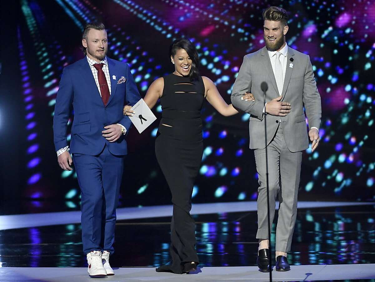 Josh Donaldson, from left, Gina Rodriguez, and Bryce Harper present the best female athlete award at the ESPY Awards at the Microsoft Theater on Wednesday, July 13, 2016, in Los Angeles.