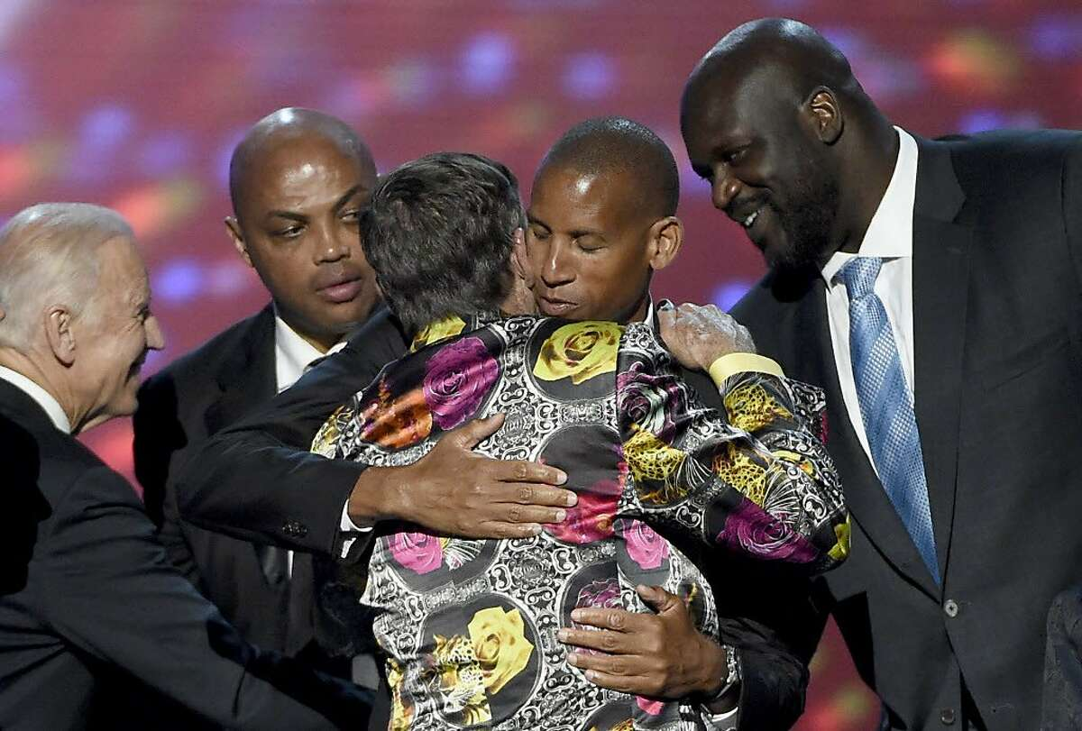 Vice President Joe Biden, left, and former NBA players Charles Barkley, Reggie Miller, and Shaquille O'Neal, right, congratulate Craig Sager as he accepted the Jimmy V award for perseverance at the ESPY Awards at the Microsoft Theater on Wednesday, July 13, 2016, in Los Angeles. (Photo by Chris Pizzello/Invision/AP)