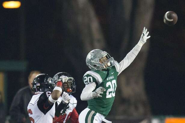 De La Salle Spartans defensive back Tre White (20) jumps  to block the pass during the second half of the CIF Open Division state championship football game, Saturday, Dec. 19, 2015, at Hornet Stadium in Sacramento, Calif.