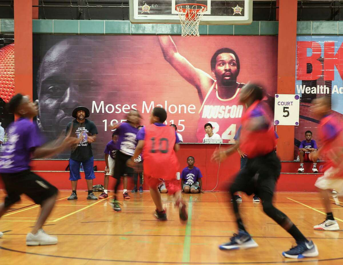 Teams play in front of a mural of Moses Malone at the Fonde Recreation Center during the 21st Annual Harris County Street Olympics' 3-on-3 Basketball Championship Tournament on Wednesday, July 13, 2016, in Houston.