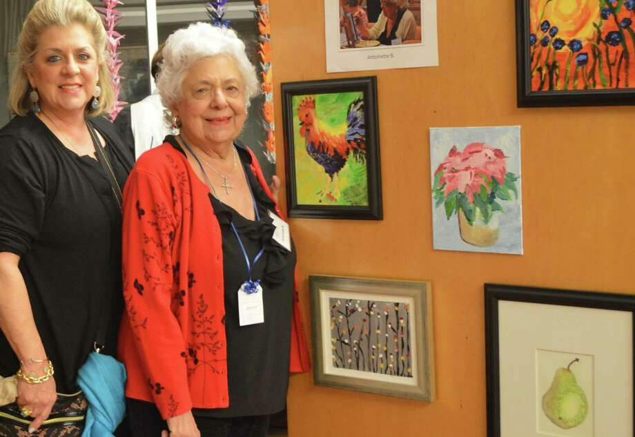 Amazing Place participant Antoinette and her daughter view an art exhibit at Amazing Place.
