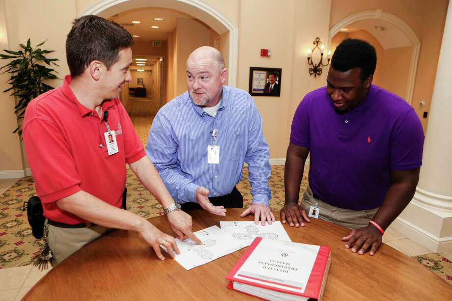 Dragoslav Lukic, Rick Ellis and Jalon Chambers  discuss hurricane plans at Parkway Place.