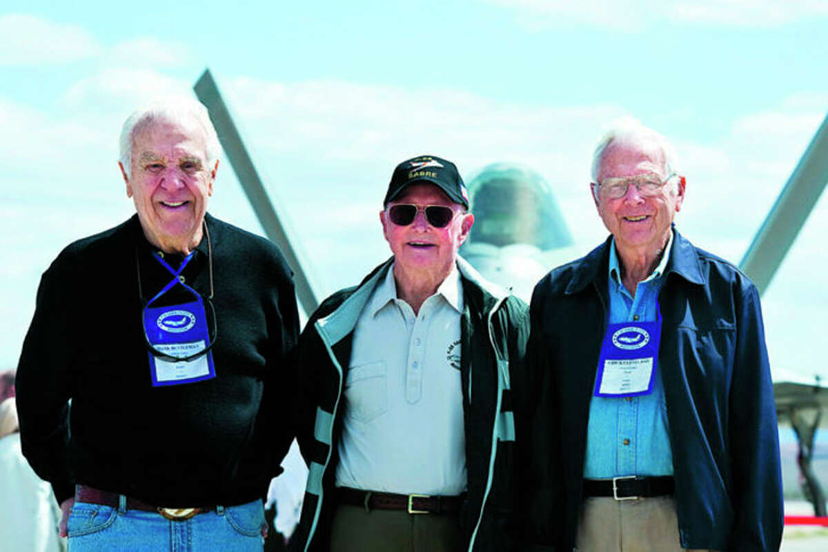 From left, Hank Buttleman, Cecil G. Foster and Chick Cleveland, retired Air Force Korean War flying aces, pose in front of an F-22 Raptor April 9, 2013, during a Sabre Society tour at Nellis Air Force Base, Nev. Foster was credited with shooting down nine enemy aircraft during aerial combat during his military service. A Midland native, Foster died July 5 at his home in Montana.