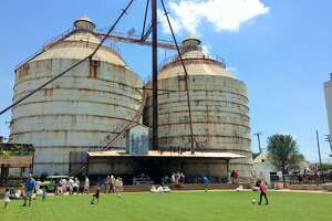 The silos at Magnolia Market loom over the children's play area.