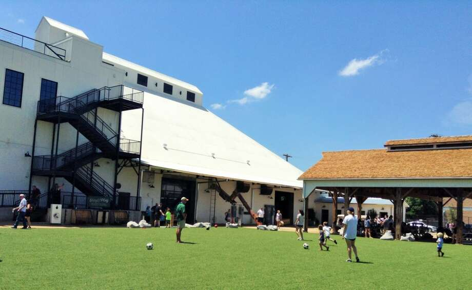 Magnolia Market's artificial turf field is popular with children. Photo: Tom Orsborn /San Antonio Express-News