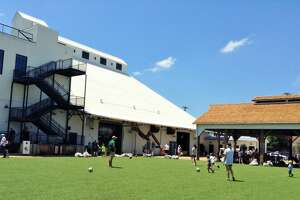 Magnolia Market's artificial turf field is popular with children.