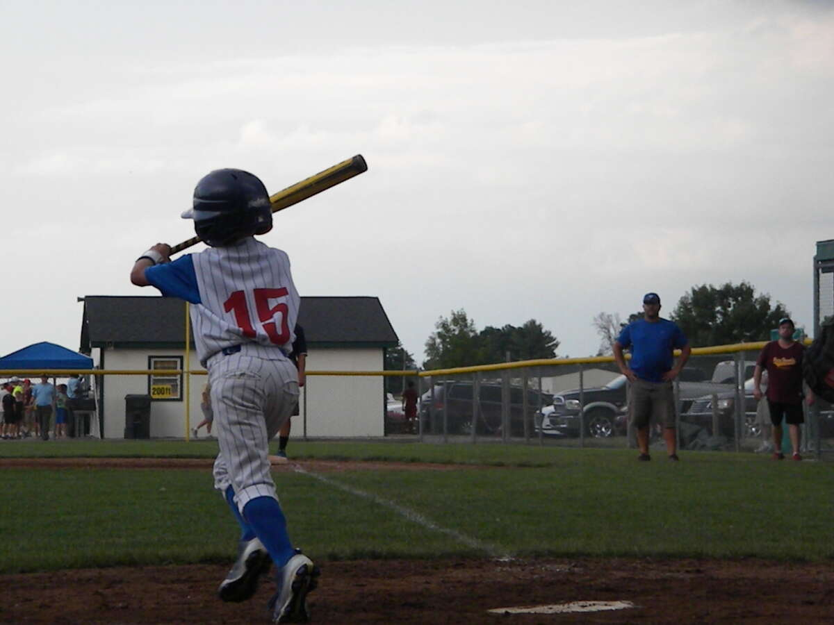 Midland Northeast's Adam Haag lays down a bunt in Wednesday's 10U district game against Union Township.