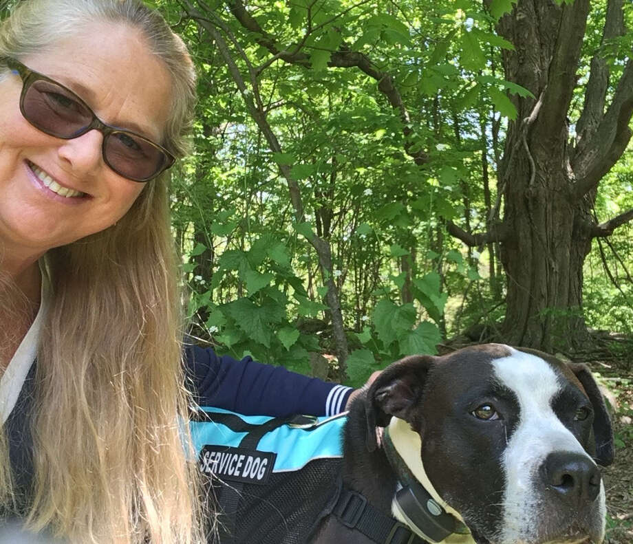 Julia Fettig and Poncho the service dog. Photo: Contributed Photo