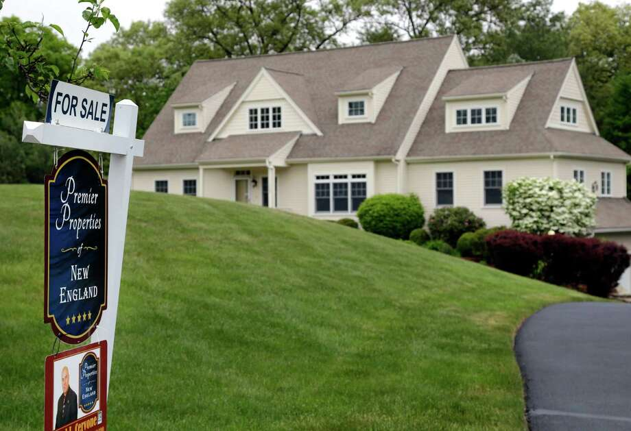 Mortgage giant Freddie Mac says the average for the benchmark 30-year fixed-rate mortgage ticked up to 3.42 percent from 3.41 percent last week, staying close to its all-time low of 3.31 percent in November 2012. Photo: Elise Amendola /Associated Press / Copyright 2016 The Associated Press. All rights reserved. This material may not be published, broadcast, rewritten or redistribu