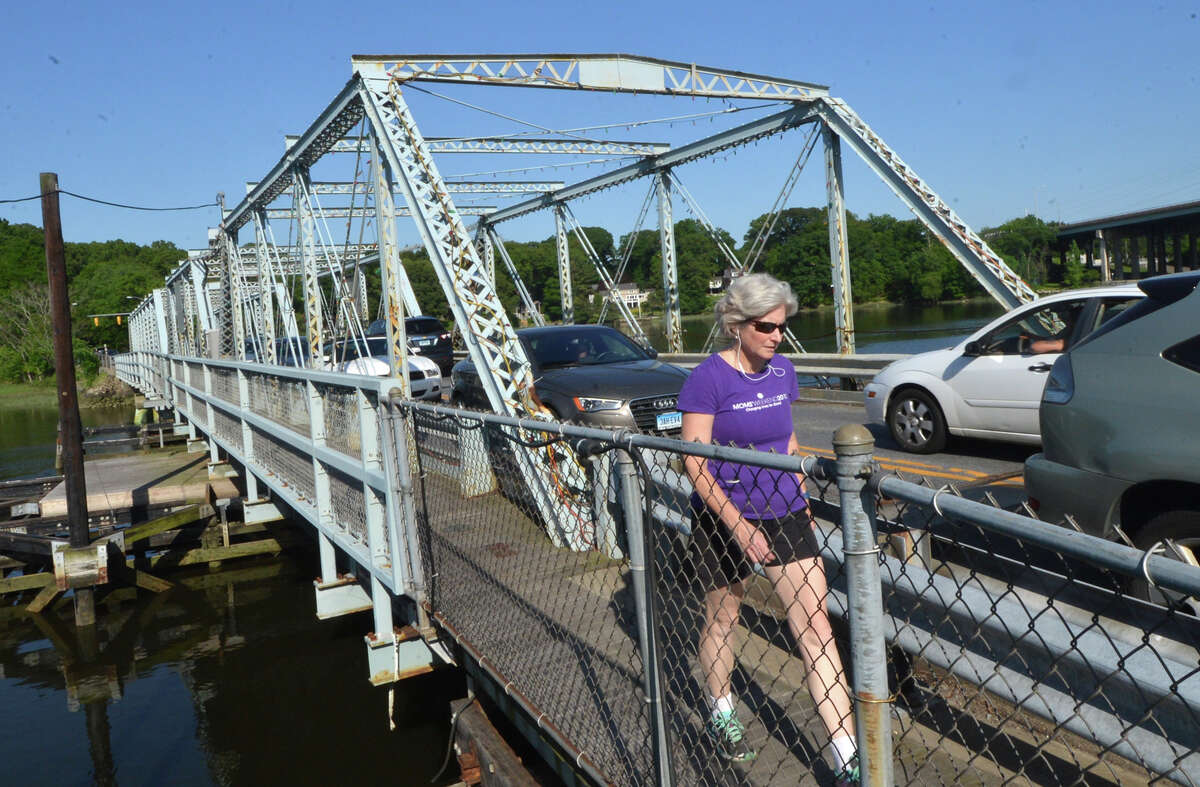 Pedestrians and cars travel over the William Cribari Memorial Bridge over the Saugatuck River during rush hour on Tuesday May 31 in Westport, Conn.