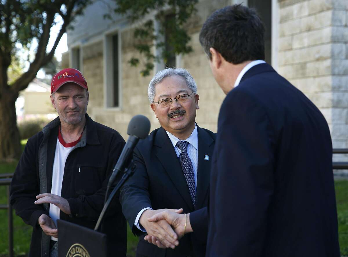 Mayor Ed Lee meets with Michael Blecker (right), executive director of Swords to Plowshares, at a dedication ceremony for veterans housing at the Presidio in San Francisco, Calif. on Tuesday, Nov. 3, 2015.