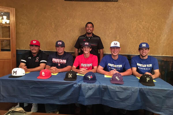 From left, SETX Jays teammates Ramiro Sanchez (Memorial), Austin Fitts (Bridge City), Kody Kolb (Nederland), Chase Warren (PN-G) and Tristan Bowlen (Vidor) sit before coach Jessie Riojas in a college signing ceremony Wednesday evening in Port Arthur. (Photo provided by Jessie Riojas)