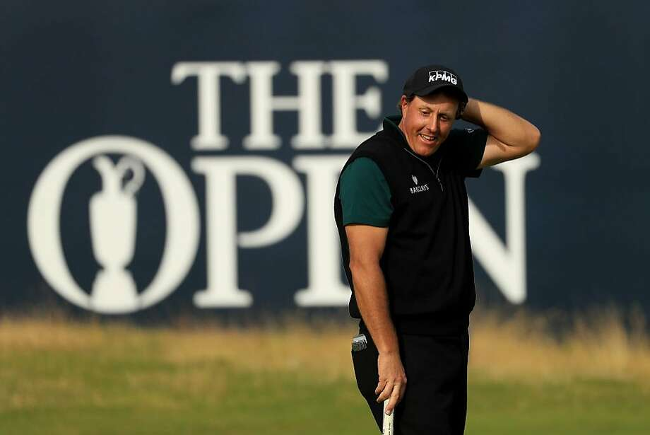TROON, SCOTLAND - JULY 14:  Phil Mickelson of the United States reacts after his birdie putt narrowly missed the hole on the 18th during the first round on day one of the 145th Open Championship at Royal Troon on July 14, 2016 in Troon, Scotland.  (Photo by Mike Ehrmann/Getty Images) Photo: Mike Ehrmann, Getty Images