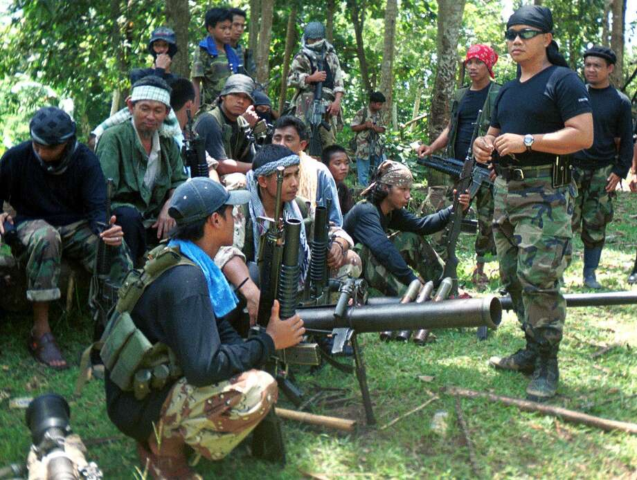 Abu Sayyaf members in Basilan, the Philippines, are best known for banditry and kidnappings. Photo: Associated Press