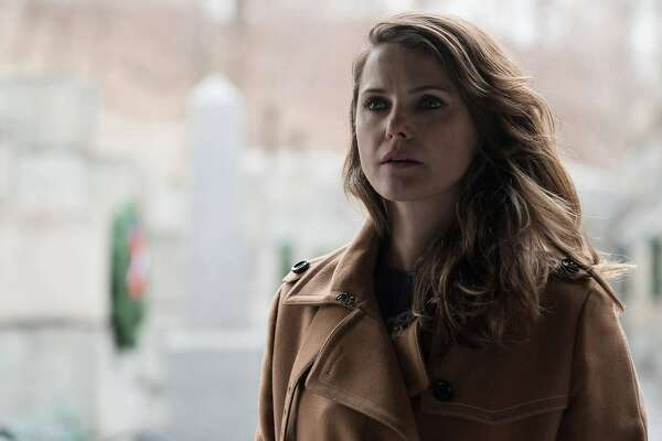 "In this image released by FX, Keri Russell appears in a scene from ""The Americans."" The program was nominated for outstanding drama series on Thursday, July 14, 2016. Russell was also nominated for outstanding actress in a drama series. The 68th Primetime Emmy Awards will be broadcast live on ABC beginning at 8 p.m. ET on ABC. (Ali Goldstein/FX via AP)"