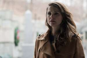 """In this image released by FX, Keri Russell appears in a scene from """"The Americans."""" The program was nominated for outstanding drama series on Thursday, July 14, 2016. Russell was also nominated for outstanding actress in a drama series. The 68th Primetime Emmy Awards will be broadcast live on ABC beginning at 8 p.m. ET on ABC. (Ali Goldstein/FX via AP)"""