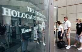"FILE - In this June 12, 2009, file photo, people stand in line to enter the U.S. Holocaust Memorial Museum in Washington. The U.S. museum is requesting that smartphone users refrain from ""catching"" Pokemon when they are inside the museum. Museum Communications Director Andrew Hollinger tells The Washington Post that officials are trying to reach game developers to get the museum removed as a prominent location in the popular new ""Pokemon Go"" smartphone game."