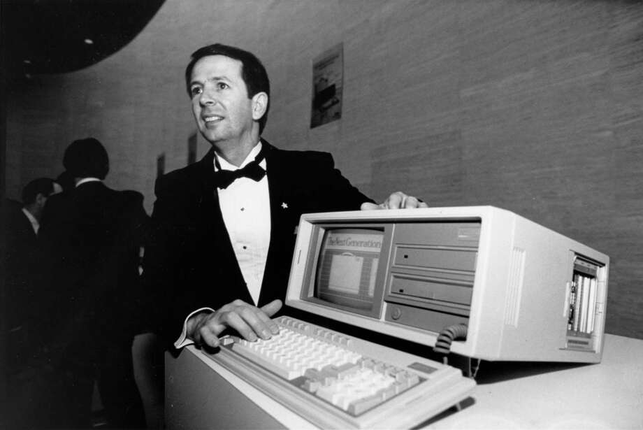 Compaq founders Jim Harris, from left, Bill Murto and Rod Canion pose in 1982 with their IBM-compatible portable computer. Photo: Manuel M. Chavez, HP Staff / Houston Chronicle