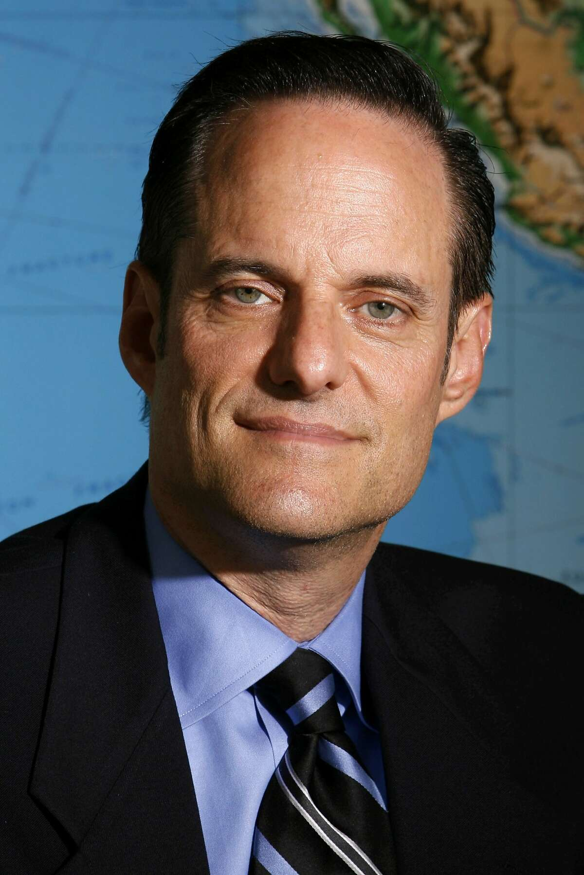 AIDS Healthcare Foundation President Michael Weinstein poses for a portrait in his office in Los Angeles August 8, 2006. A proposal in Congress to require that more of the federal money spent on uninsured AIDS patients go to drugs and doctor visits is drawing criticism from some AIDS groups, who say it will force cuts in basic services like meals and housing. Photo taken August 8, 2006. REUTERS/Danny Moloshok (UNITED STATES)
