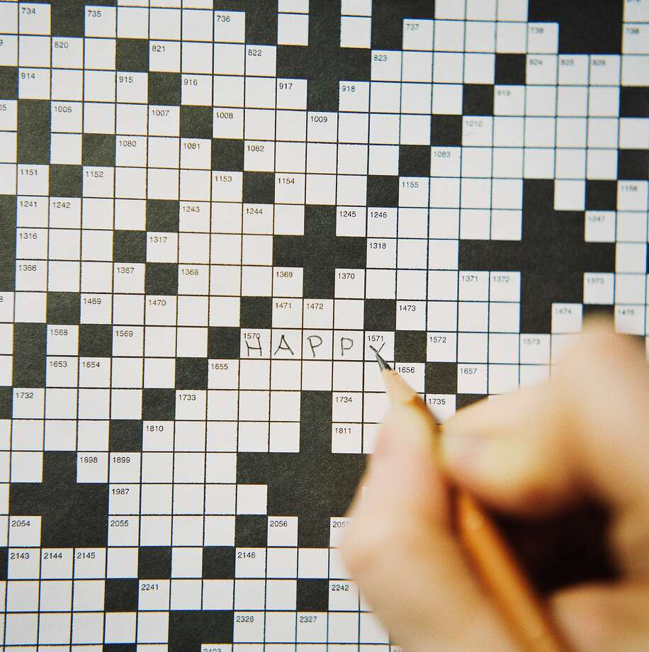 Unlike this person, a visitor to the Neues Museum in Germany used a ballpoint pen to solve clues on a crossword-themed artwork. Photo: Snap Decision, Getty Images