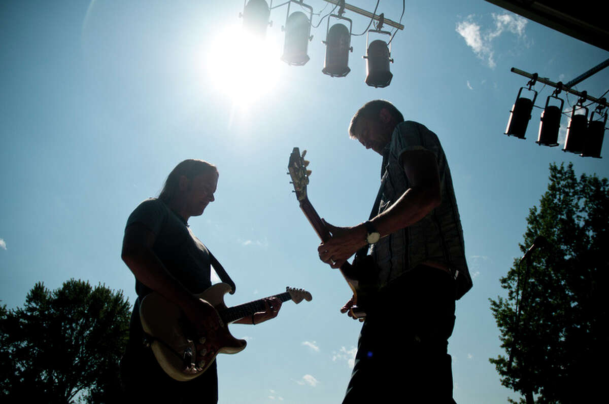 LIBBY MARCH | for the Daily NewsLou Musa, left, and Brian Vander Ark of Verve Pipe play part of a song early Friday evening at Chippewassee Park during a sound check for the band's performance a few hours later as part of RiverDays.