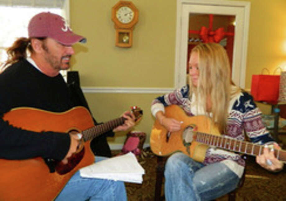 NIKY HOUSE  for the Daily News Bobby Randall and Melissa Lee Zenker perform locally during Confederate Railroad's down times.