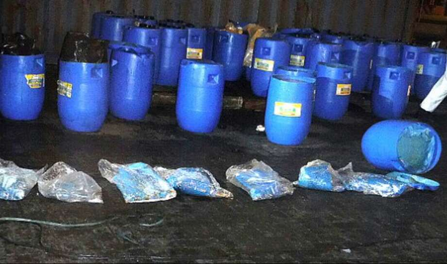 Mexican authorities seized 13 tons of cocaine hidden in barrels full of hot sauce in July 2016. The drugs are believed to be linked to the Sinaloa Cartel, which Joaquin 'El Chapo' Guzman is a member of.  Photo: Marine Secretary Of Mexico