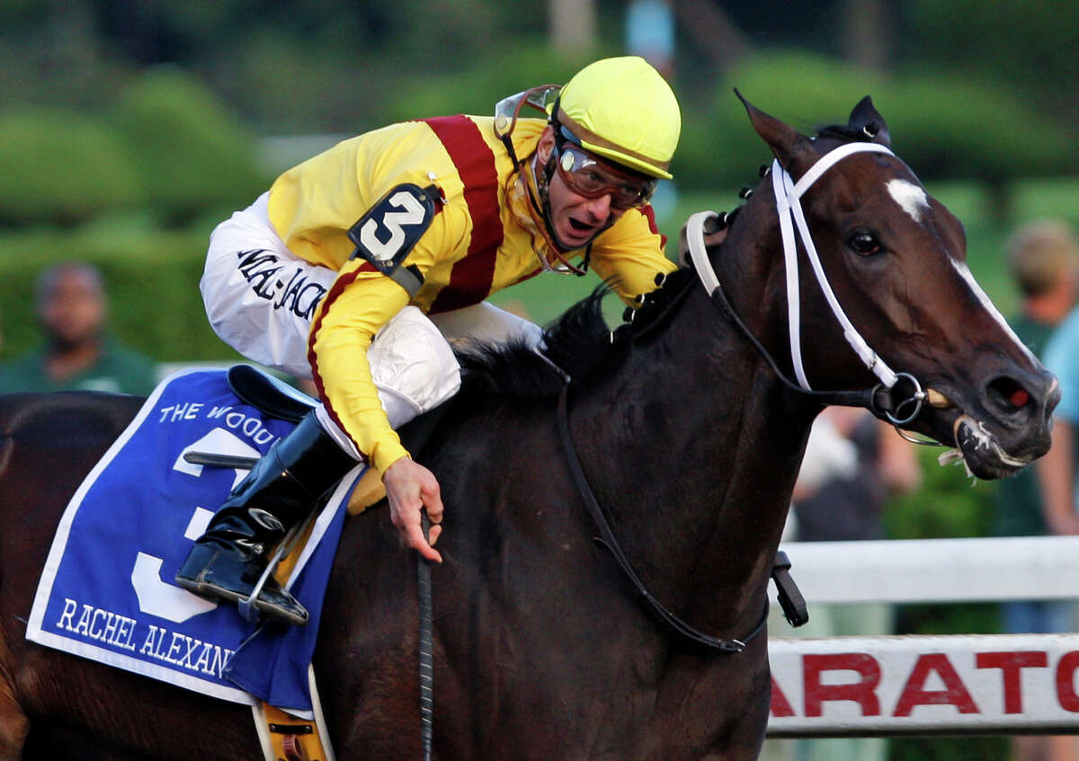 FILE - In this Sept. 5, 2009, file photo, Rachel Alexandra, ridden by jockey Calvin Borel, wins in the Woodward Stakes horse race at Saratoga Race Course in Saratoga Springs, N.Y. Rachel Alexandra remains in serious but stable condition following surgery related to complications from the birth of her filly. Doctors at Rood and Riddle Equine Clinic said Thursday, Feb. 14, 2013, that it's