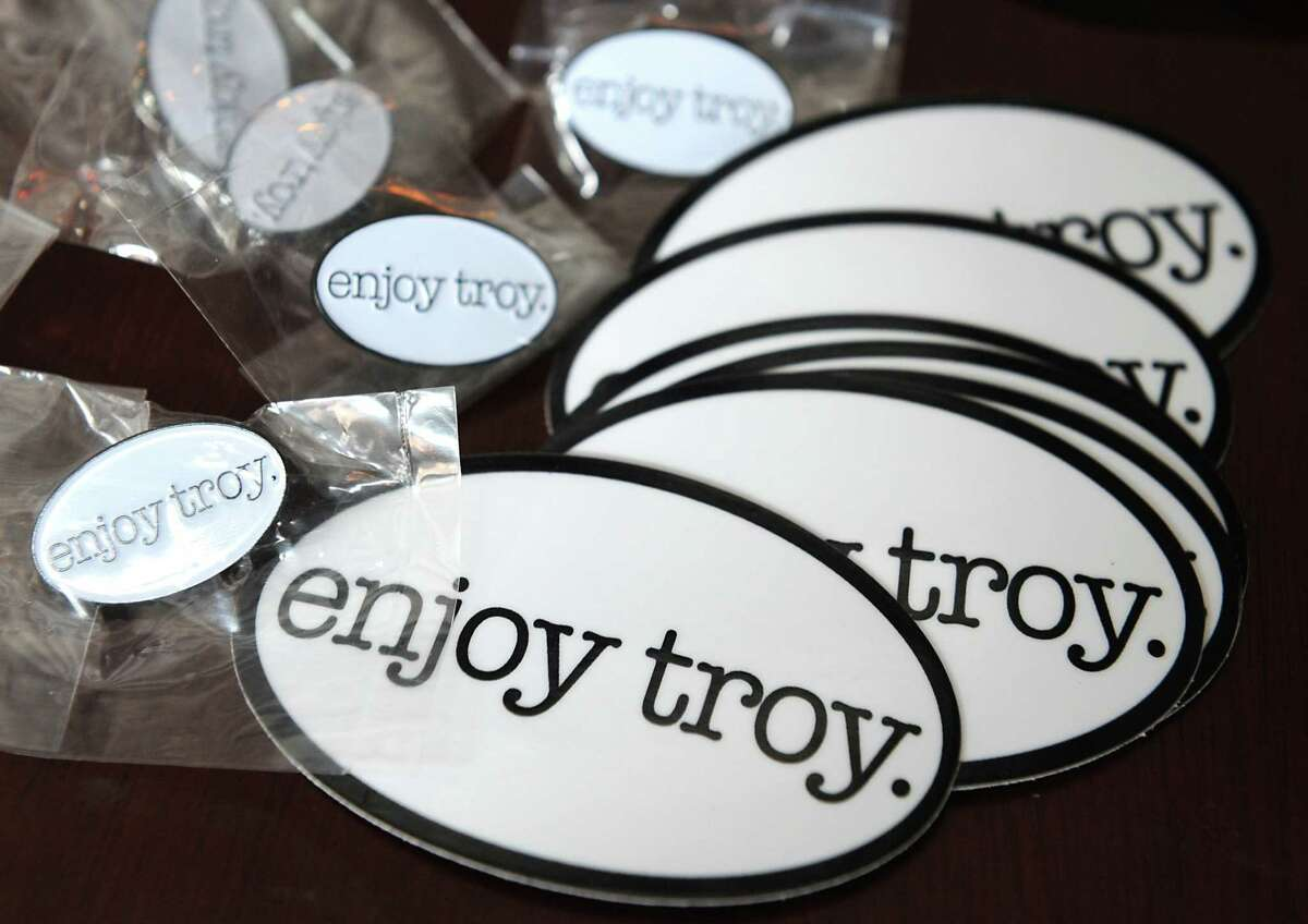 Pins and stickers from the Enjoy Troy Co. were passed out at Peck's Arcade on Tuesday, Jan. 6, 2015 in Troy, N.Y. (Lori Van Buren / Times Union)