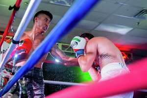 Steven Hall (right) takes a punch from Armando Cardenas during their pro boxing match on Aug. 8, 2015, at the San Antonio Event Center.