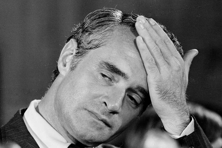 Then- Sen. Thomas Eagleton reacts while listening to then- presidential hopeful Sen. George McGovern's announcement that Eagleton is stepping aside as vice-presidential running mate, at a Washington news conference, in this Aug. 1, 1972 file photo. Eagleton, who resigned as Sen. McGovern's vice presidential nominee after it was revealed he had been hospitalized for depression, was in critical condition at a St. Louis hospital Saturday, March 3, 2007 the state Democratic Party chairman said. (AP Photo) Photo: AP