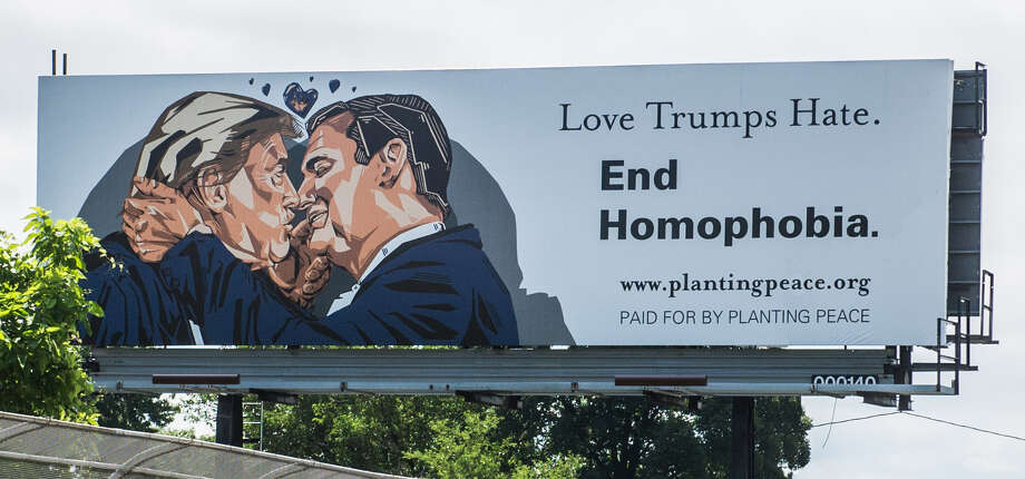 A full-size billboard showing presumptive Republican nominee Donald Trump poised to plant a kiss on the lips of Texas Senator Ted Cruz went up today in Cleveland, Ohio. Photo: Planting Peace