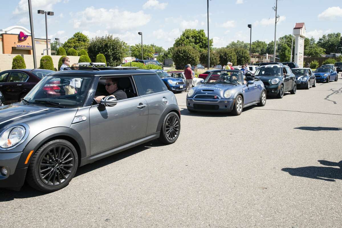 About 1000 Mini Coopers stopped in Midland at the Gourmet Cupcake Shoppe during the biennial Mini Takes the States rally stop in Midland on Thursday.
