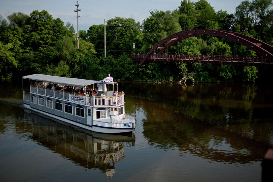 NICK KING | nking@mdn.net  The Grand Princess Riverboat makes it's way toward the Tridge during a ride on Friday evening during River Days. / Midland Daily News