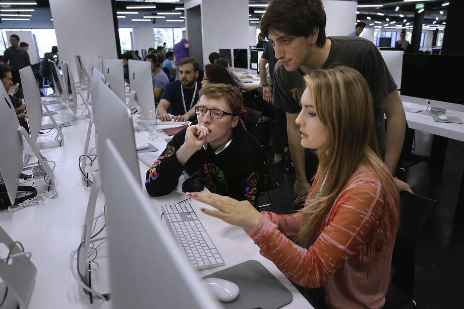 Jordan Williams (left), Ross Levine and Iuliia Iliuk work together to solve a problem at the tuition-free school. Photo: Michael Macor, The Chronicle