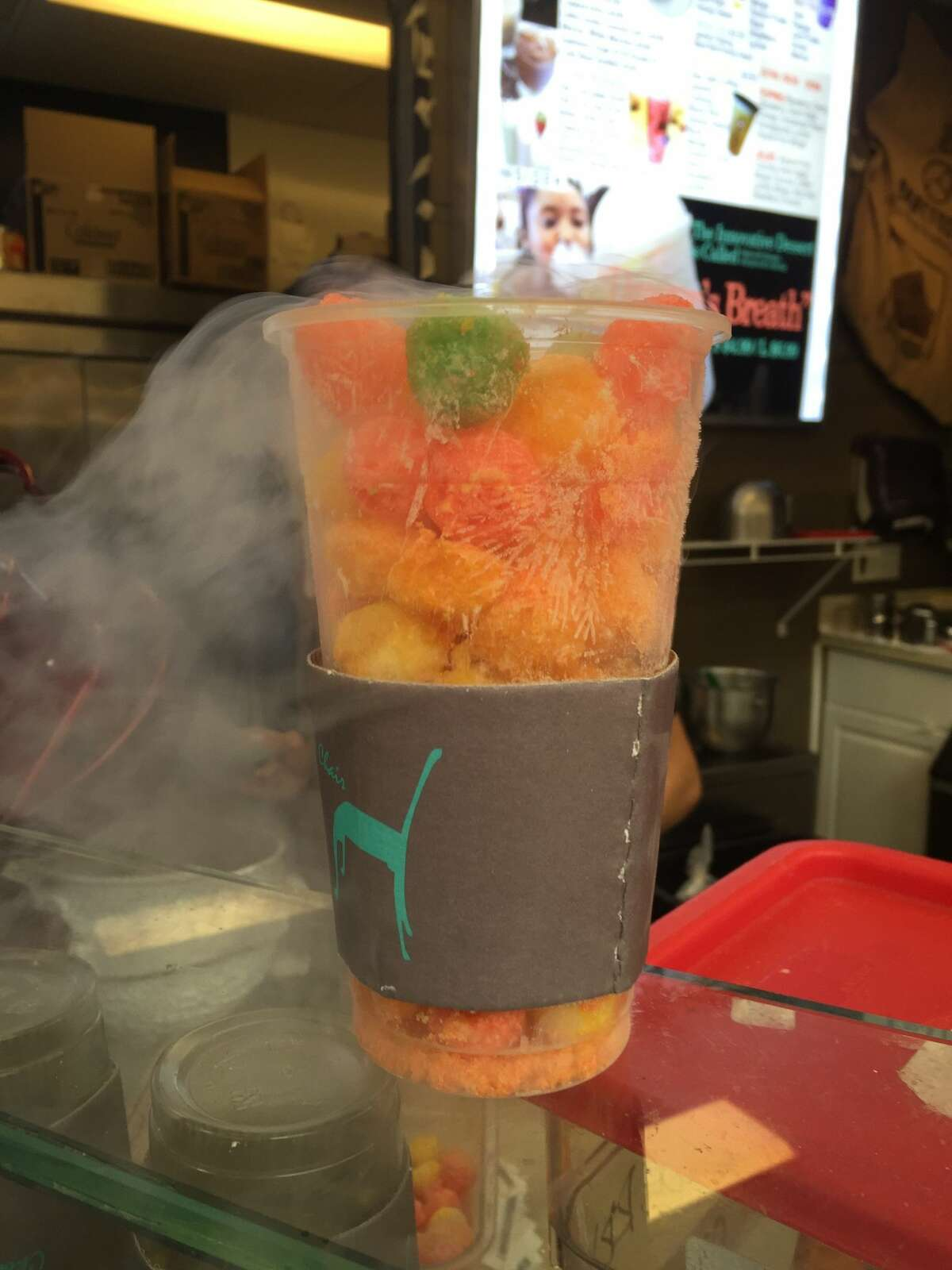 Dragon's Breath cereal puffs soaked in liquid nitrogen emit a fog-like gas at Chocolate Chair in San Francisco's Japantown.