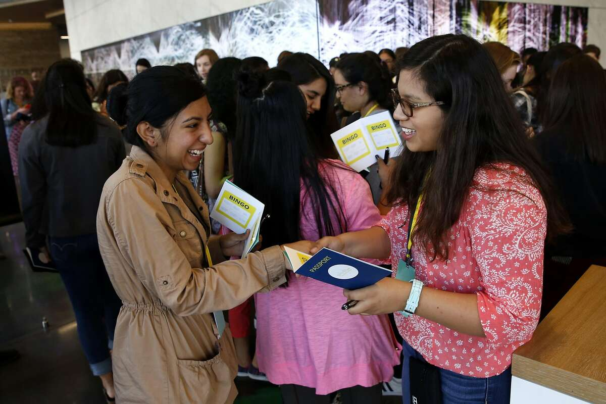 Maria Cardenas (left) and Paulina Gonzalez meet during a networking exercise at a Girls Who Code event at the Dolby Laboratories headquarters in San Francisco, California, on Thursday, July 14, 2016.