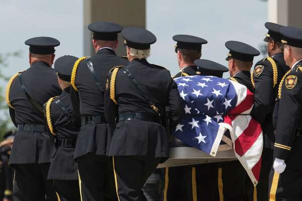 An honor guard escorts the casket of Officer Brent Thompson in Dallas on July 1. The man who killed him and four other Dallas officers during an otherwise peaceful vigil acted alone.