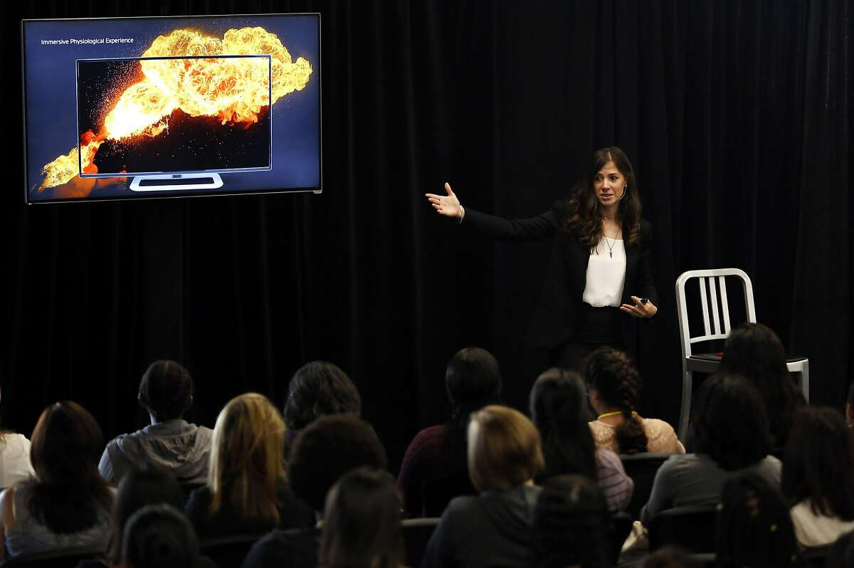 Poppy Crum, head scientist, talks to high schoolers during a Girls Who Code event at Dolby Laboratories headquarters in San Francisco, California, on Thursday, July 14, 2016.