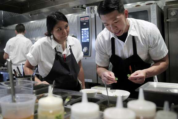Brandon Chang, a line cook at Mister Jiu's, right, chats with TK as he helps to prep dinner service at the restaurant in San Francisco, Calif., on Tuesday, July 12, 2016.
