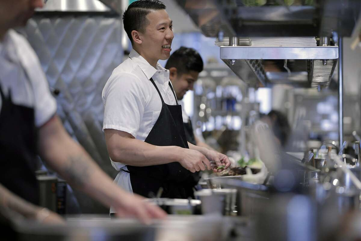 Brandon Chang, a line cook at Mister Jiu's helps to prep dinner service at the restaurant in San Francisco, Calif., on Tuesday, July 12, 2016.