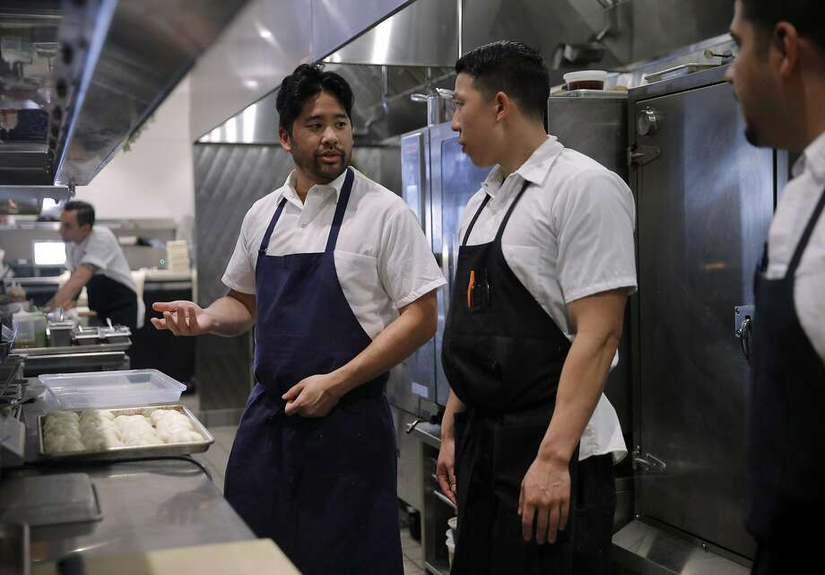 Chef Brandon Jew (left) chats with Brandon Chang, a line cook at Mister Jiu's. Photo: Carlos Avila Gonzalez, The Chronicle