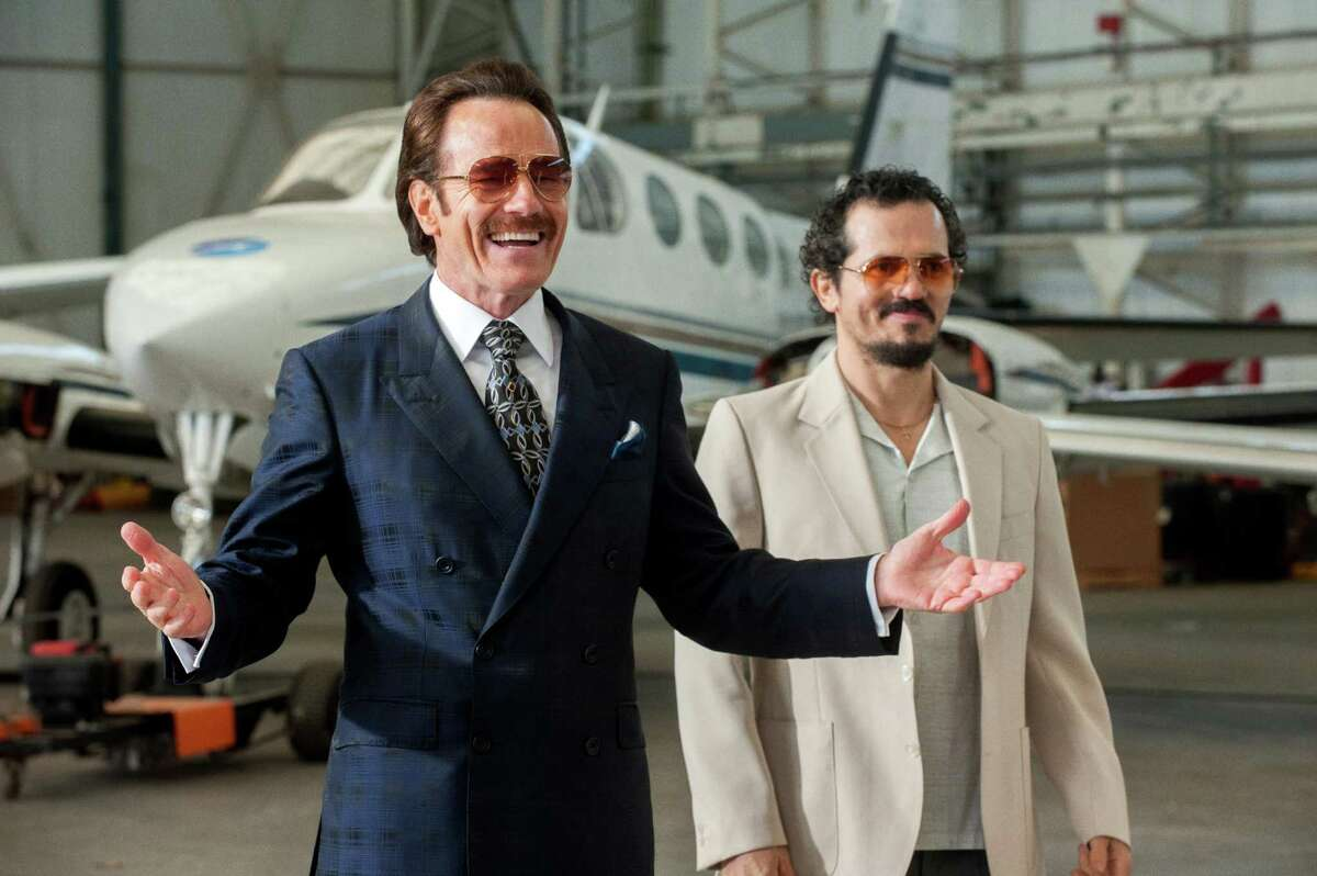"""Bryan Cranston, left, and John Leguizamo star as undercover customs agents in """"The Infiltrator."""""""