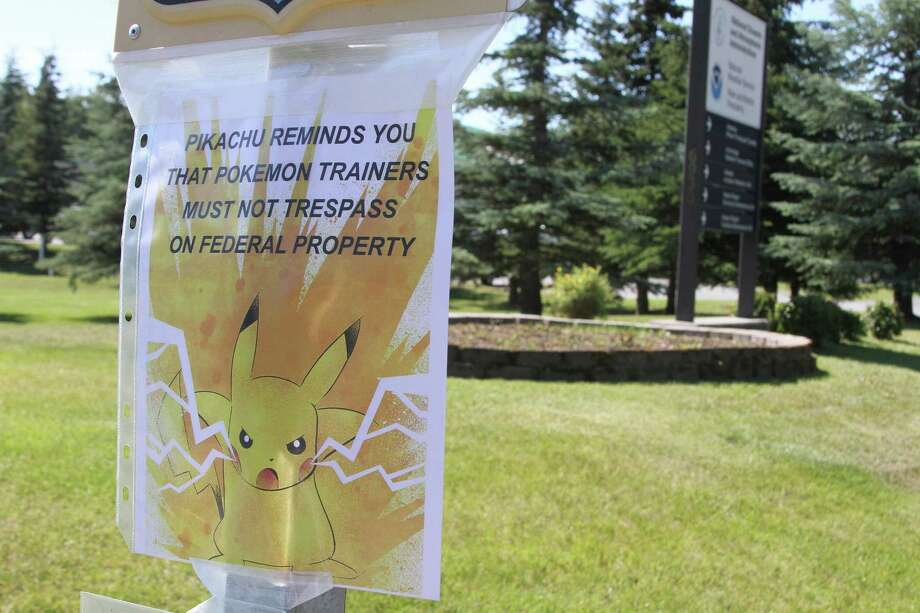 """A sign at the National Weather Service in Anchorage, Alaska, informs """"Pokémon Go"""" players that it's illegal to trespass on federal property. The """"Pokémon Go"""" craze across the U.S. has people wandering into yards, driveways, cemeteries and even an off-limits police parking lot in search of cartoon monsters, prompting warnings that trespassers could get arrested or worse. Photo: Mark Thiessen /Associated Press / Copyright 2016 The Associated Press. All rights reserved. This material may not be published, broadcast, rewritten or redistribu"""