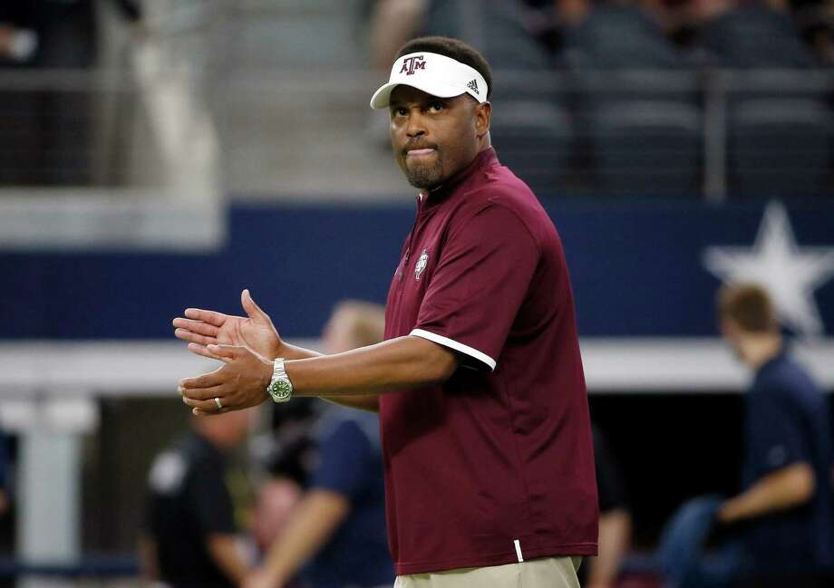 A&M coach Kevin Sumlin, shown before kickoff against Arkansas in Arlington last season, likely needs at least eight victories to save his job. Photo: Tony Gutierrez /Associated Press / AP