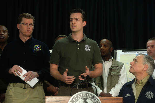 Orange County Emergency Manager Ryan Peabody addresses a question asTexas Governor Greg Abbott speaks during a press conference at the Emergency Management Center in Orange Wednesday. Abbott toured the destruction in the region before gathering at the center to meet with local officials, after which he addressed the media about the crisis and steps that will be taken to assist those affected. Photo taken Wednesday, March 16, 2016 Kim Brent/The Enterprise