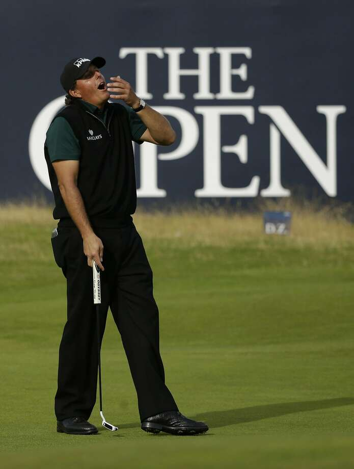 A gasping Phil Mickelson said he was heartbroken to have narrowly missed a birdie putt on the 18th green that would have given him a 62. Photo: Matt Dunham, Associated Press