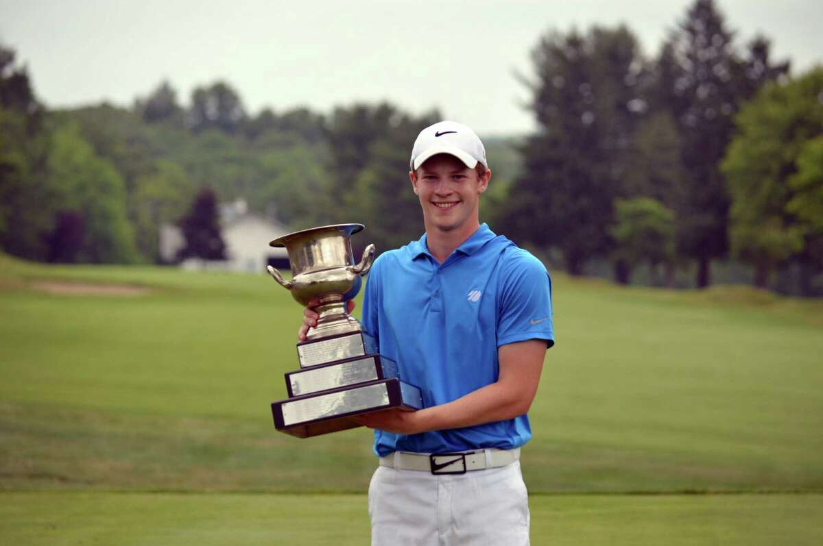 Ridgefield's Andrew Franz holds the winner's trophy at the 75th Connecticut Junior Amateur in Watertown.