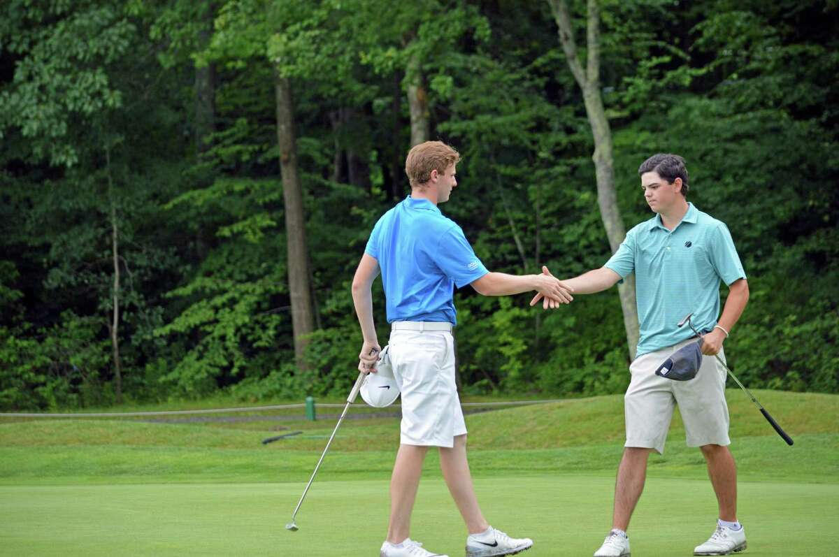 Andrew Franz of Ridgefield Golf Course shakes hands with Matt Bornstein of Silver Spring Country Club after winning the 75th Connecticut Junior Amateur on the 20th hole at Watertwon Golf Club in Watertown, Conn. July 15, 2016